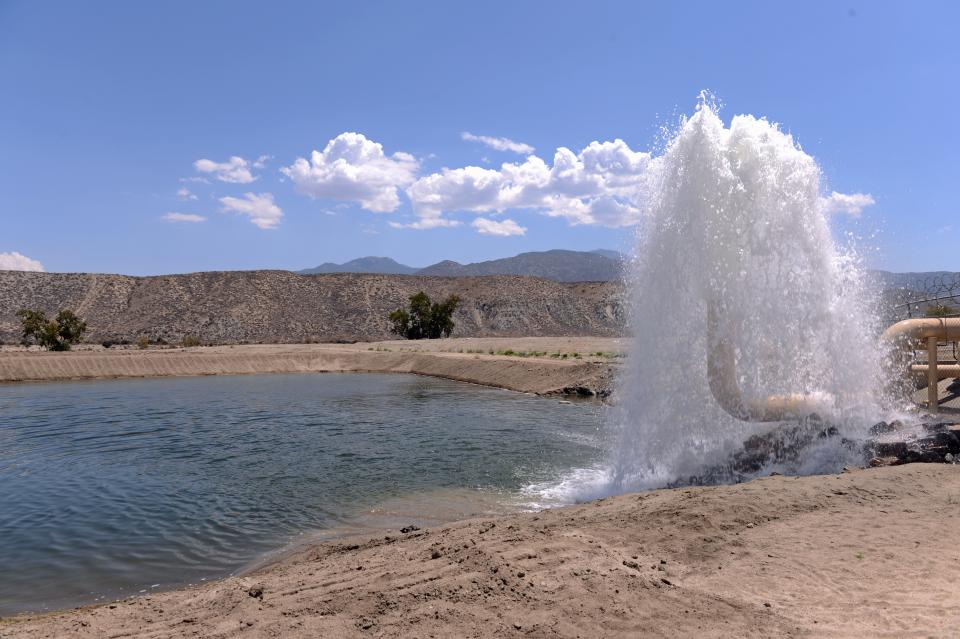 Water spout at groundwater supply pond.